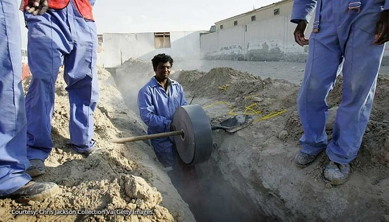 Expatriate construction workers lay a trench for cables in Al Quoz In Dubai. The Indian Consulate in Dubai plans to retrain and upskill blue-collar Indian workers in the UAE will help them navigate the challenges of the job market.
