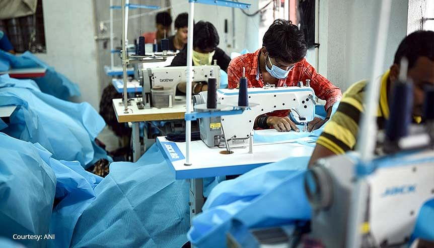 Workers preparing the PPE suits at a private manufacturing unit in Vijaywada, India. The Indian government should use the positive post-pandemic sentiment to push for bigger reforms in manufacturing.