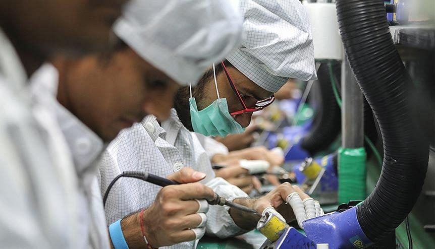 Workers solder wires on printed circuit boards of a mobile handset in a factory in India. The prospect of Korean firms shifting their base from China to India has only increased the need for companies to de-risk their strategies in the post pandemic era.