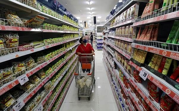 A woman shops inside the Big Bazaar retail store in India. The battle between Amazon and Reliance Retail for control of the Future Group winds its way through various international arbitration panels and Indian courts.