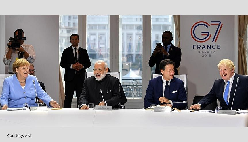 Prime Minister Narendra Modi, UK Prime Minister Boris Johnson, German Chancellor Angela Merkel in the session on 'Biodiversity, Oceans, Climate', at the G7 Summit, in 2019. India has been confirmed as one of three guest nations to join the G7 summit presided over by the UK in June this year, having been personally invited by Johnson.