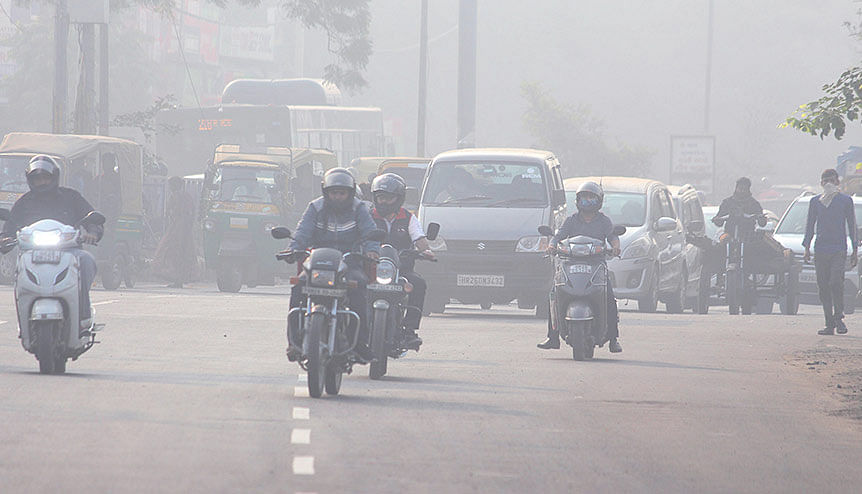 Commuters make their way through smog on the road, in Gurugram. The lockdown period to curtail the spread of Covid-19 in India saw pollution levels dropping to the lowest levels since 2018.