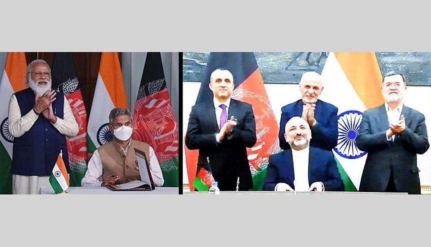 Prime Minister Narendra Modi with External Affairs Minister Dr S Jaishankar during the signing of an MoU between India and Afghanistan, on the construction of Shahtoot dam near Kabul, through video conferencing with Afghanistan President Ashraf Ghani.