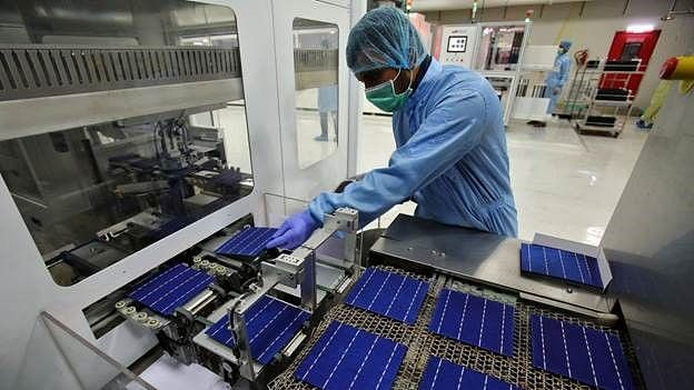 An employee works at a solar cell production line at Jupiter Solar Power Limited (JSPL) plant in Baddi, in the northern state of Himachal Pradesh. India is pushing to promote domestic manufacturing in the solar energy sector.