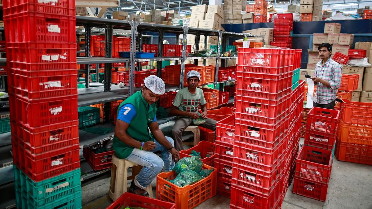 Employees sort out orders before sending them out at a Big Basket warehouse on the outskirts of Mumbai. With online shopping on the upswing the Tata Group's $1.2 billion buyout of Big Basket will turn the retail space into a highly competitive zone.