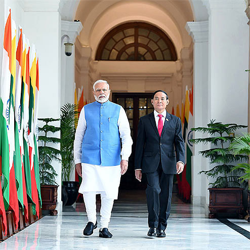 Indian Prime Minister Narendra Modi with Myanmar President U Win Myint, who has been arrested, during a meeting last year. India will follow its own interests rather than be weighed down by the policies of other countries towards the Myanmar military regime.
