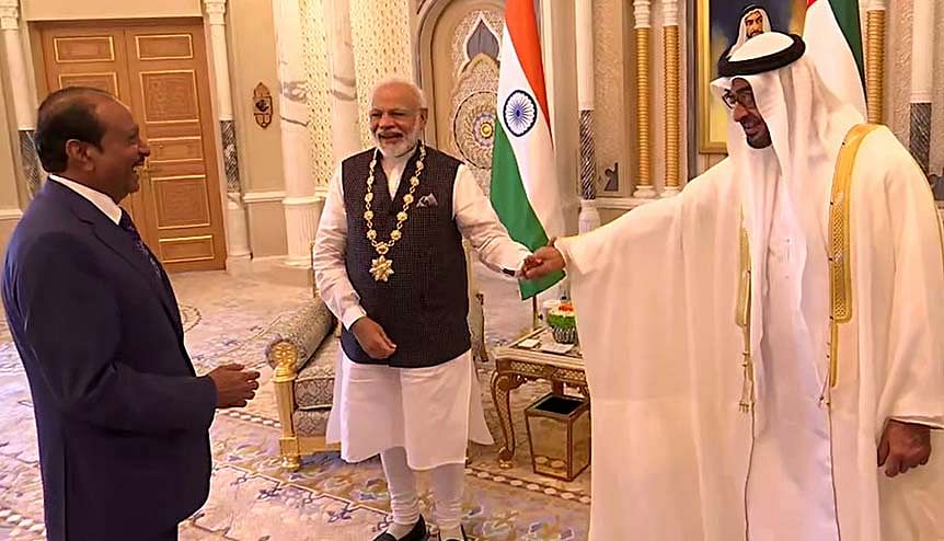 Indian PM Narendra Modi with Abu Dhabi Crown Prince Sheikh Mohammed Bin Zayed Al Nahyan after being conferred the Order of Zayed. Also seen is Yousuf Ali MA, the head of the Lulu Group of companies based in the UAE. The UAE is India's third largest trade partner with a bilateral trade of about $60 billion.