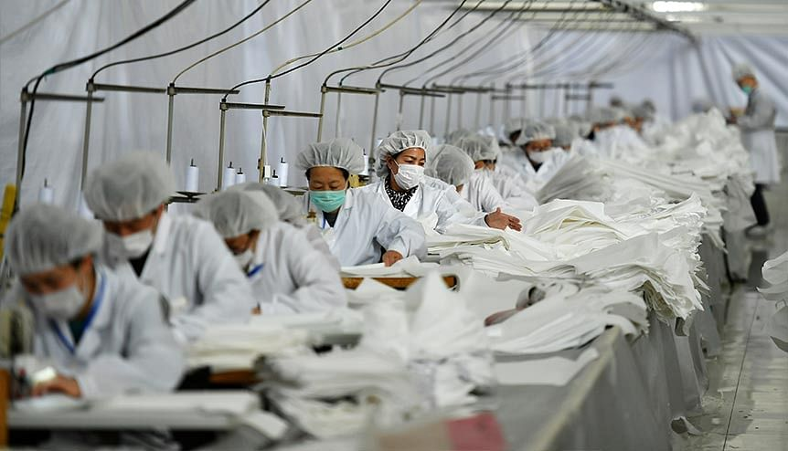 Employees at an outlet manufacturing protective suits. In manufacturing, India has one of the lowest tax jurisdictions among peer nations in Asia.
