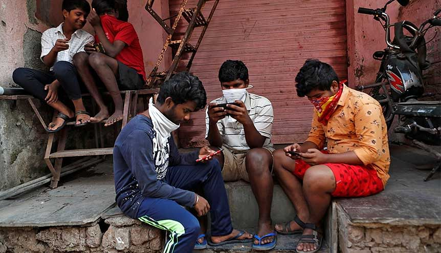 A group of boys working their mobile phones during India's nationwide lockdown. The proposed Indian data privacy law, pending since 2019, once enacted, will completely overhaul the country's data privacy regime.
