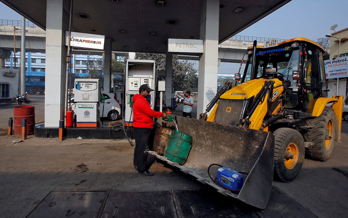 A worker fills diesel in a container at a fuel station in Kolkata, India. Output cuts by Saudi Arabia have affected the prices of fuel prices in India given the rally in global crude.