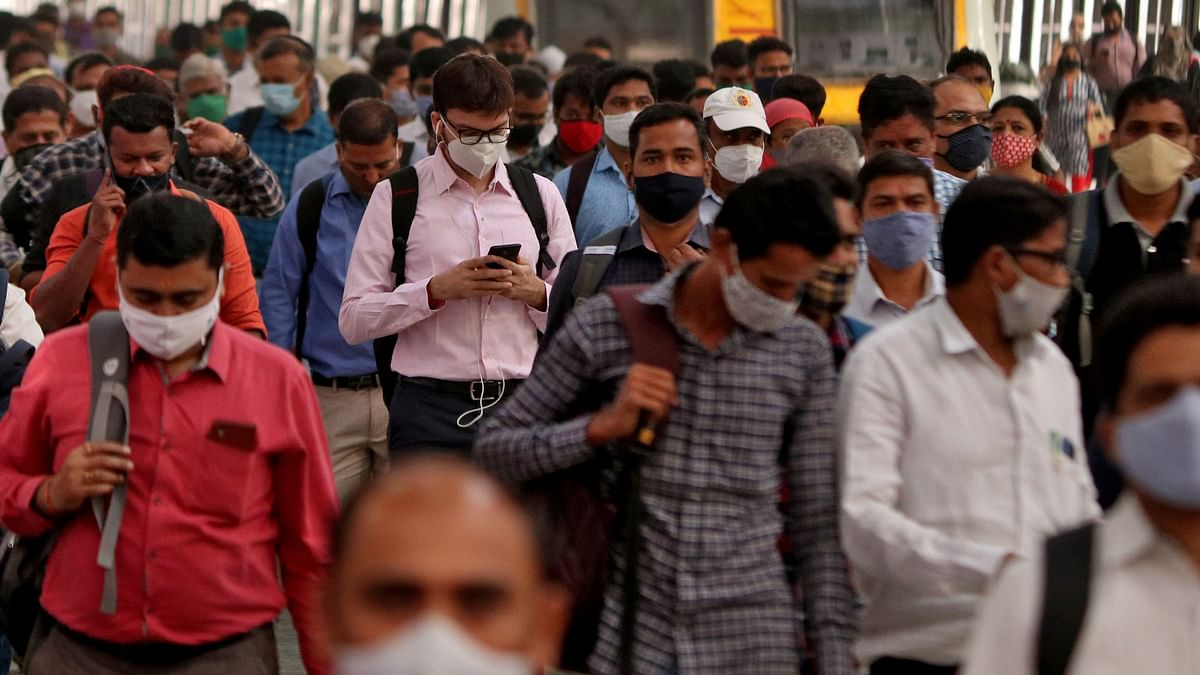 People wearing protective masks at the Chhatrapati Shivaji Terminus railway station in Mumbai. India's gross domestic product (GDP) is likely to grow 12 per cent in 2021 as near-term prospects have turned favourable.