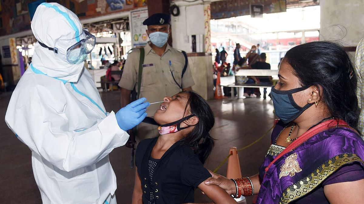 A passenger at a railway station gets a swab test. Rising Covid infections across certain states could engender a renewed health crisis and derail the robust recovery in many segments of the Indian economy.
