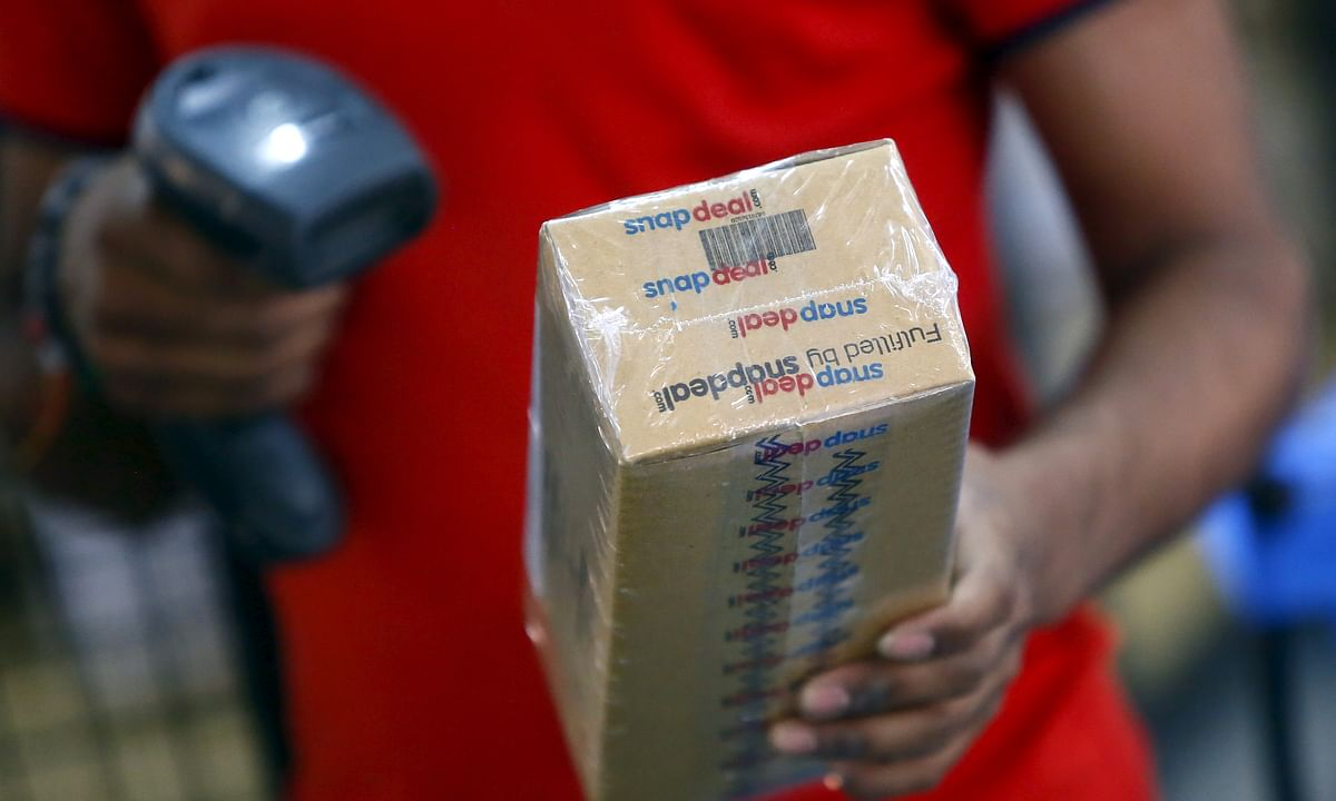 A worker from an Indian e-commerce company scans a barcode on a box after it was packed at the company's warehouse. For those who are seasoned online shoppers the playground got bigger and better – the best is yet to come.