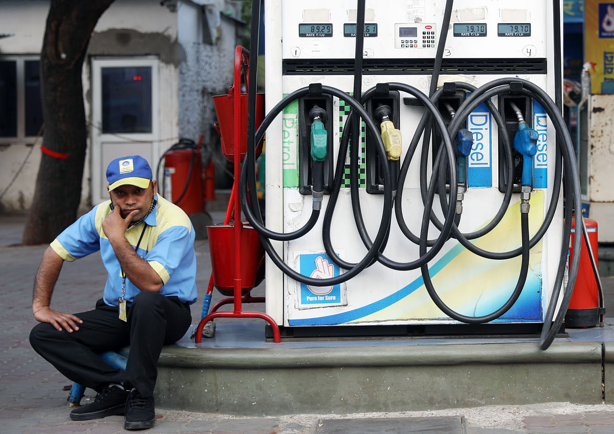 A petrol pump attendant waits for customers as national petrol and diesel prices rise at Bharat Petroleum fuel station. The government is considering the sale of PSU's, among which could be national carrier Air India and Bharat Petroleum Corporation Ltd (BPCL).