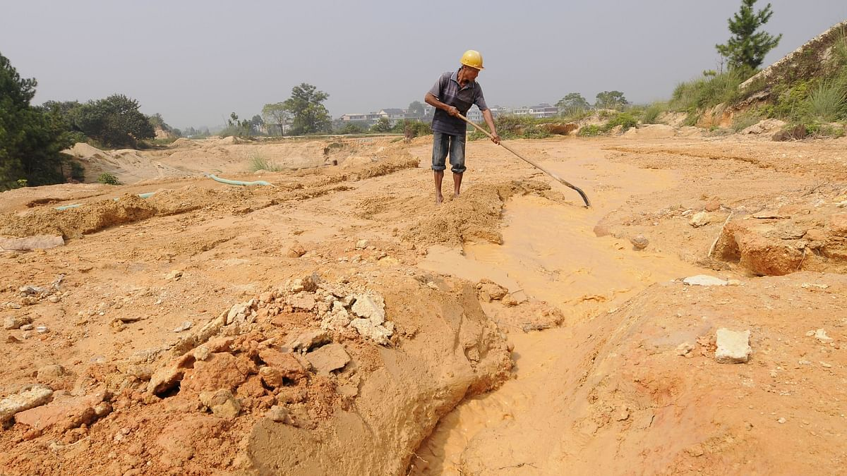 """A labourer works at the site of a rare earth metals mine at Nancheng county, Jiangxi province. China, which produces about 60 per cent of the world's rare earths, has been """"weaponising"""" this dominance to try and blackmail others into toeing its line."""