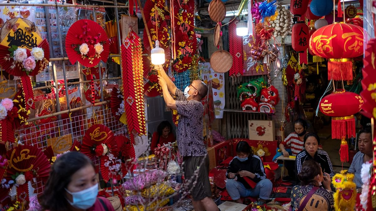 Vendors preparing their decorative goods at the Spring Festival Fair in the Old Quarter in Hanoi, Vietnam. Over the past two decades bilateral trade between India and Vietnam has grown from $200 million to 12.3 billion.