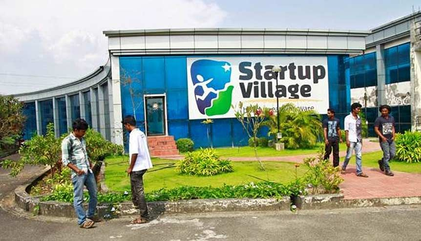 Employees stand outside the Start-up Village in Kinfra High Tech Park in the southern Indian city of Kochi. Startup Village wants to break the logjam by helping engineers develop 1,000 Internet and mobile companies in the next 10 years.