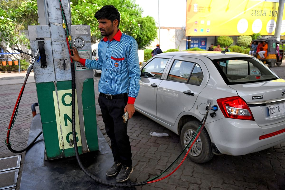 A worker refill a vehicle by CNG (compressed natural gas) which is an eco-friendly alternative to gasoline at a CNG Refilling station. Higher fuel prices in India brought about by external factors could pose a risk to inflation. But the country is slowly coming to terms with the benefits of alternative to petrol and diesel.