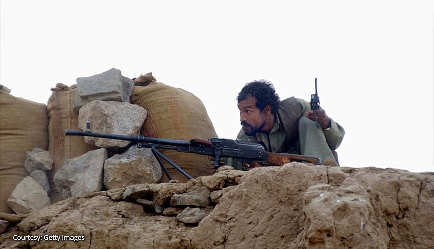 A Northern Alliance soldier fires on a Taliban position October 22, 2001 in the Northern Alliance controlled village of Deu Saraka. The withdrawal of US troops from Afghanistan will leave the field clear for the Pakistan-backed Taliban to take over again.