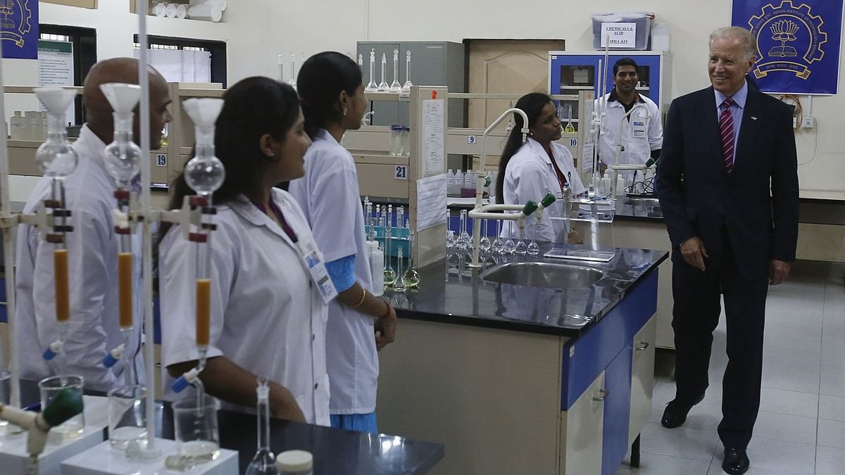 File photo of current US president Joe Biden meets students in a lab at the IIT campus in Mumbai in 2013. India's AICTE is aligning itself with contemporary processes to offer students flexibility to pursue courses without limiting their choice of subjects. This will also ensure that those who cannot afford to study abroad will benefit from a quality education and degrees at home.