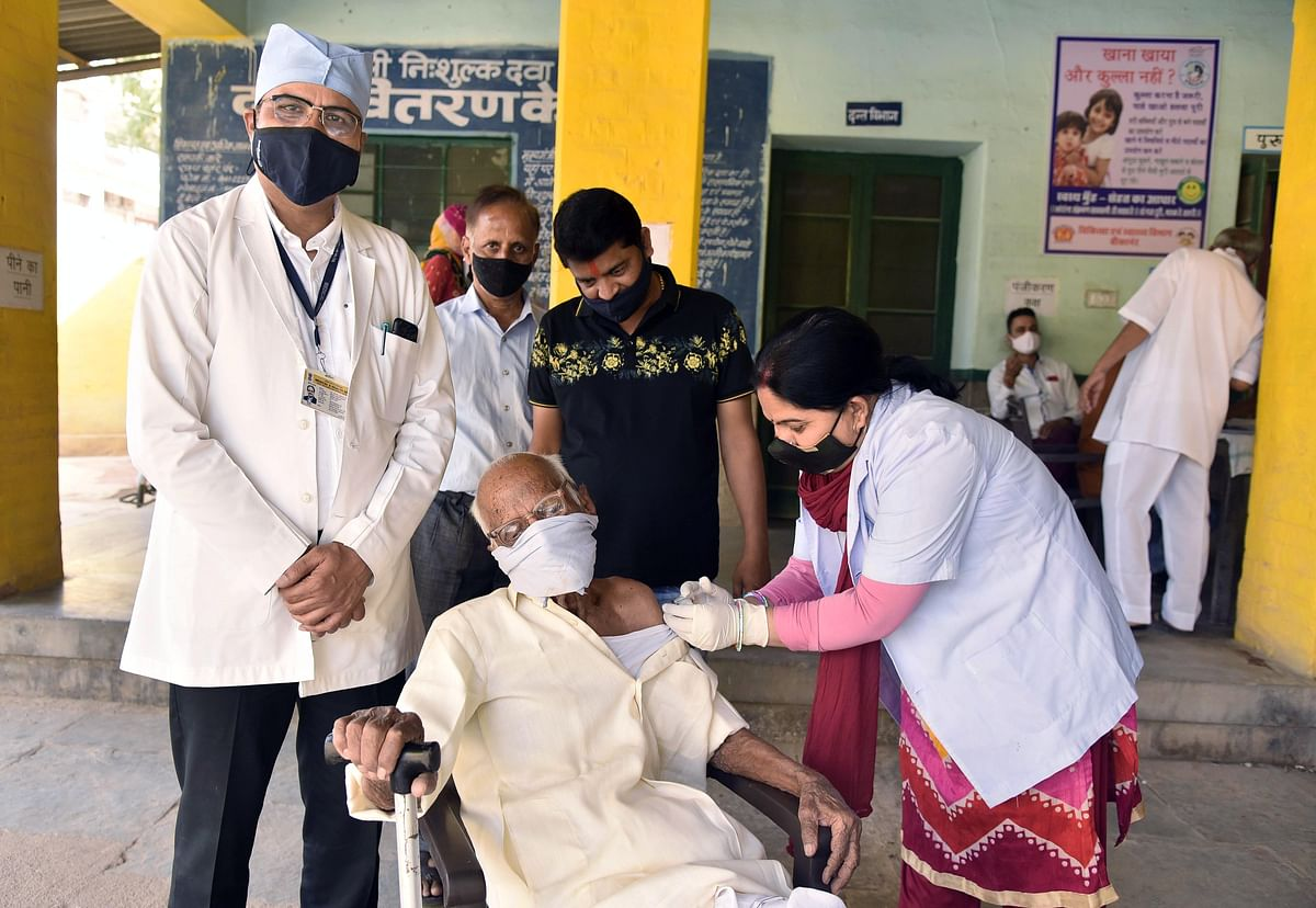 A senior citizen in rural India being administered a vaccine. The scale of India's internal programme is astounding given all the challenges the authorities have to surmount.