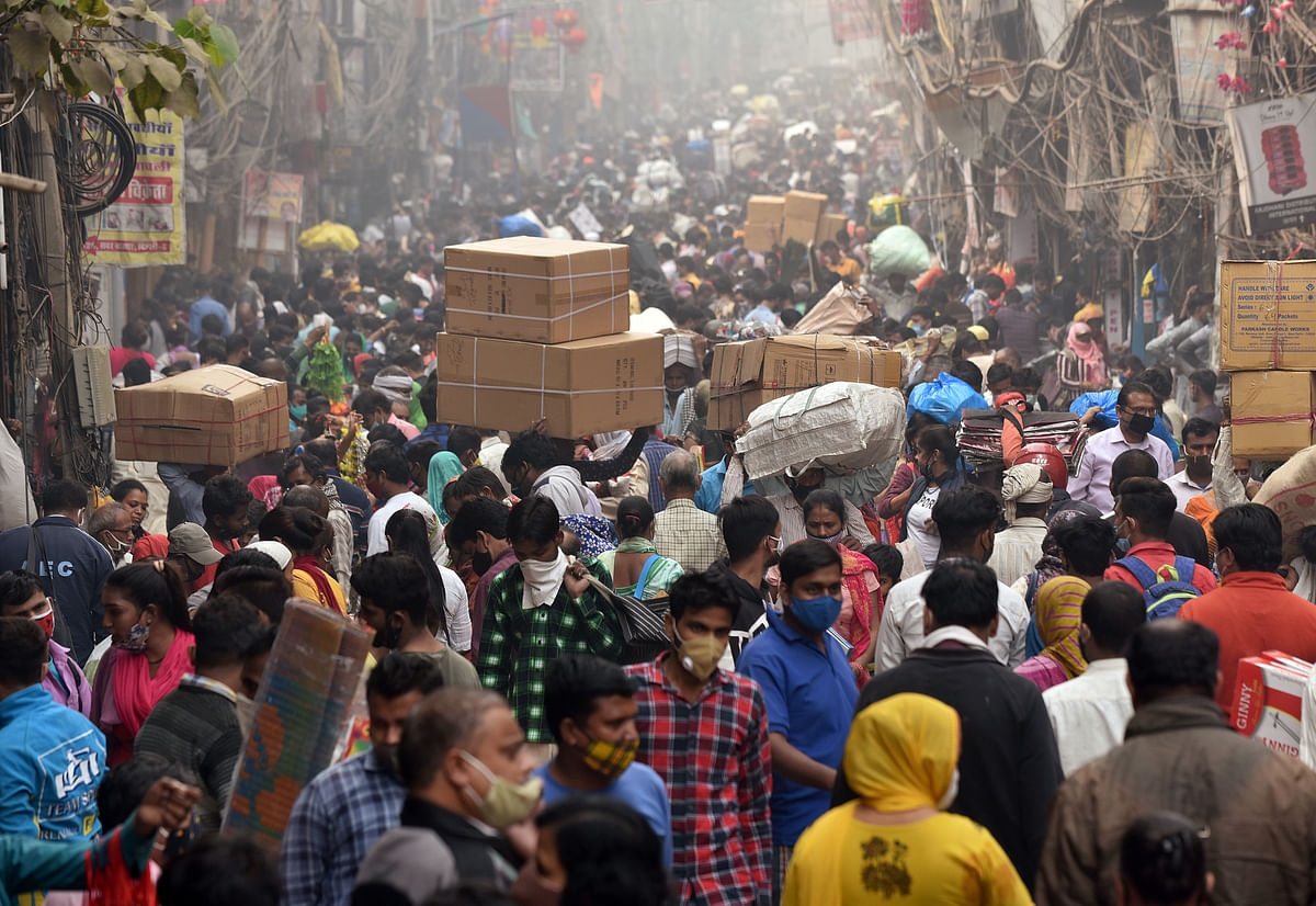 Shoppers throng a market-place. Many experts welcome the deepening and broadening of India's equity culture, they also caution investors to take lessons from previous boom-bust cycles.