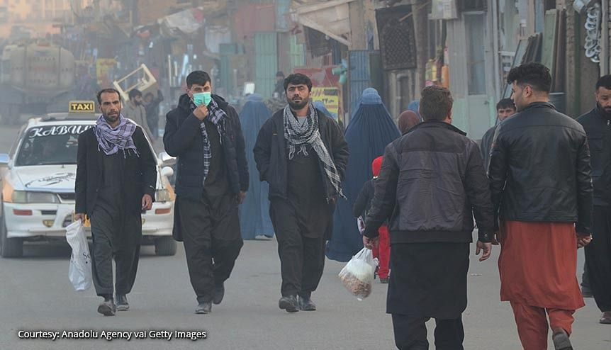 An Afghan man wears a face mask as he walks in a busy bazar in Kabul, Afghanistan. Since the overthrow of the brutal Taliban government by Allied forces in 2001, India has invested billions of dollars in Afghanistan.