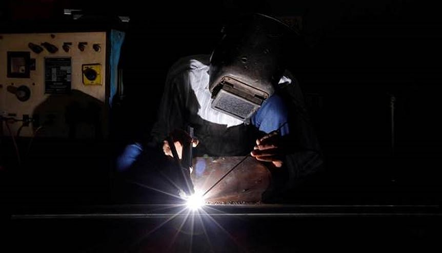A worker welds a pipe at an automobile gear box manufacturing unit in Ahmedabad. Foreign companies are seeking fresh pastures in India following a breakaway from China.