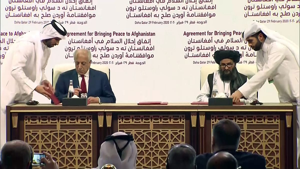 Future tense? US Special Representative for Afghanistan Zalmay Khalilzad and Mullah Abdul Ghani Baradar, the Taliban group's top political leader signing a peace agreement between Taliban and US in Doha last year.