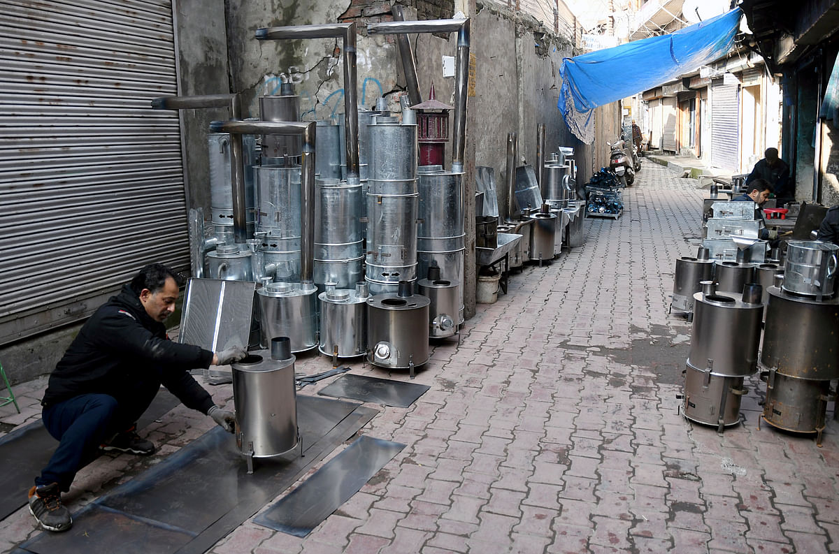 A Kashmiri labourer makes a coal heater use to keep houses warm during the winters in Srinagar. India's lifestyle is still rooted in sustainable traditional practices.