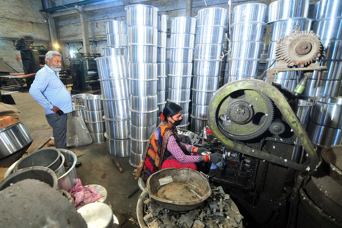 Labourers work in a utensil manufacturing factory at Micro, Small and Medium Enterprises (MSME) unit in Gangyal industries. USAID cash injections into India  during the pandemic have helped migrant workers and micro, small, and medium-sized enterprises to sustain their work.