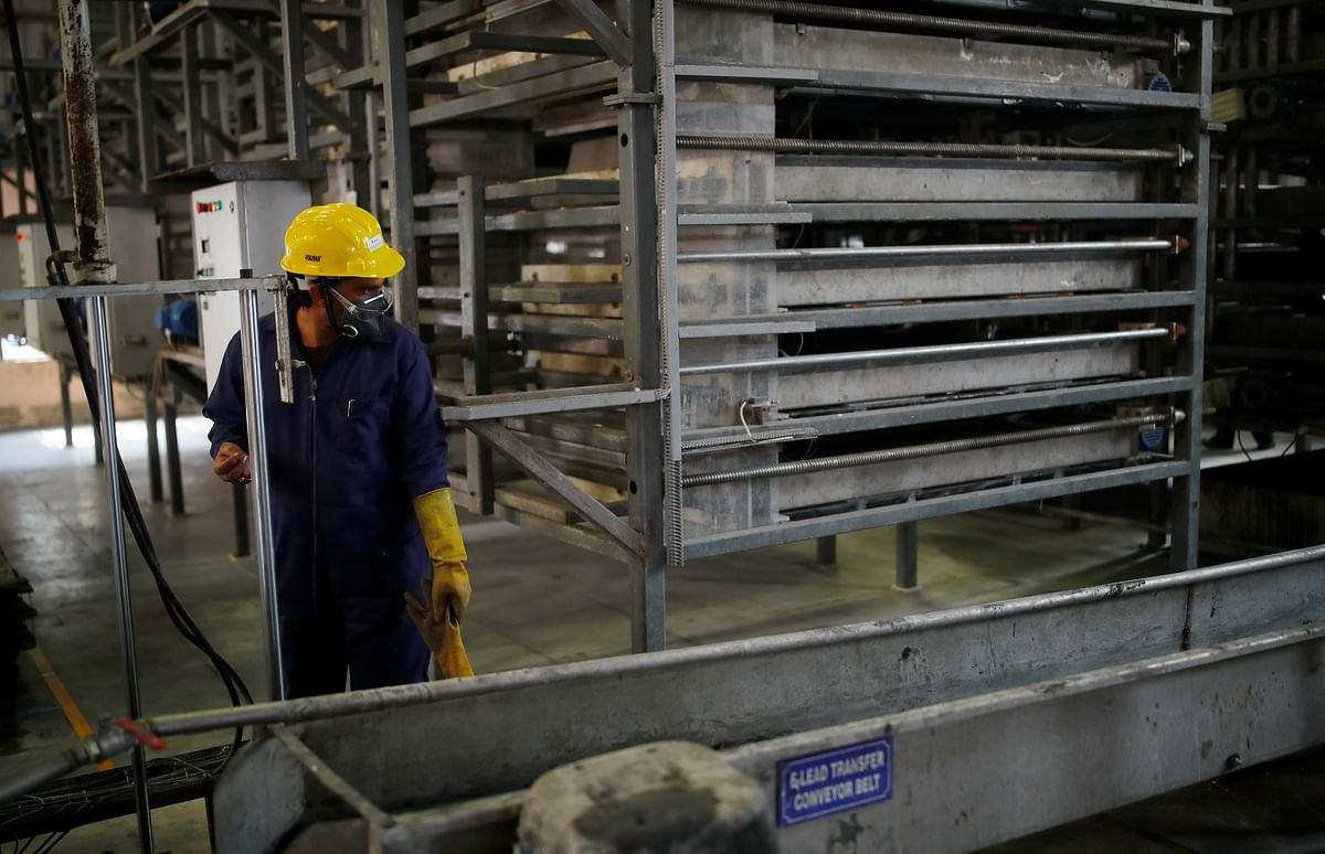 A worker stands next to a proprietary machine, which turns lead from scrap batteries into briquettes, at ACE Green Recycling Inc. An estimated 85 per cent of lead in use today goes into batteries, mostly for automobiles.