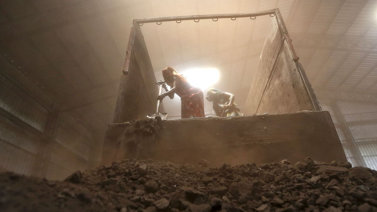 Workers unload coal from a supply truck at a yard on the outskirts of the western Indian city of Ahmedabad. Shockingly, even 73 years after Independence, only 10 per cent of India's geological potential of 0.571 million sq km has been explored.