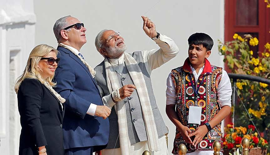 Indian prime minister Narendra Modi flies a kite watched by his Israeli counterpart Benjamin Netanyahu and his wife Sara. India, Israel and the UAE are poised to reap the benefits of a unique tri-lateral partnership following the restoration of diplomatic ties between Tel Aviv and Abu Dhabi.