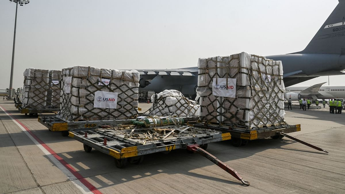 US army personnel prepare to unload COVID-19 relief supplies in New Delhi. The US has been criticised for hoarding more vaccines than it needs.