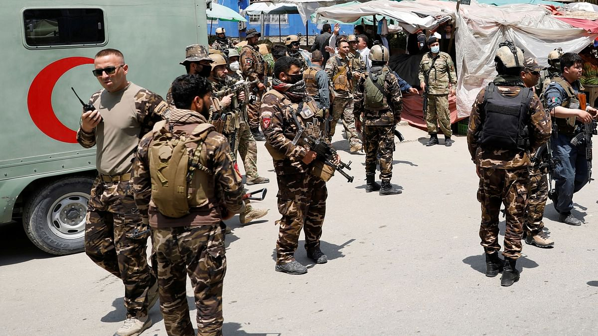Afghan security forces stand guard outside a hospital which came under attack in Kabul. It is believed that the Taliban along with other foreign actors could cripple the country.