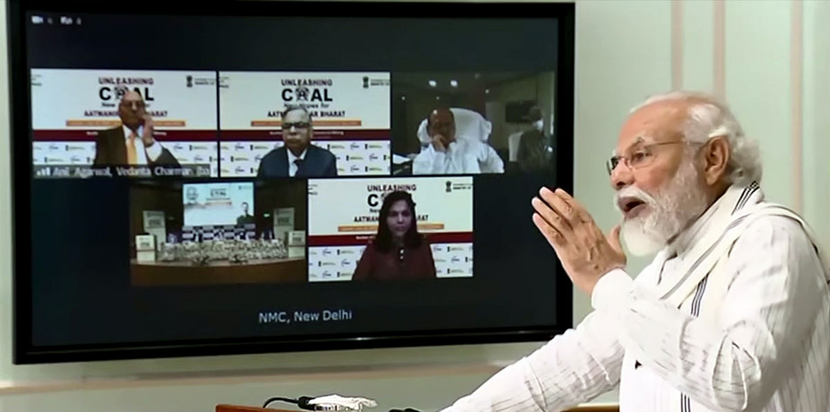 Indian PM Narendra Modi addresses an event, via video conference, during the auction of 41 coal mines. The authorities are aiming to keep a bare minimum presence in certain sectors which includes coal mines.