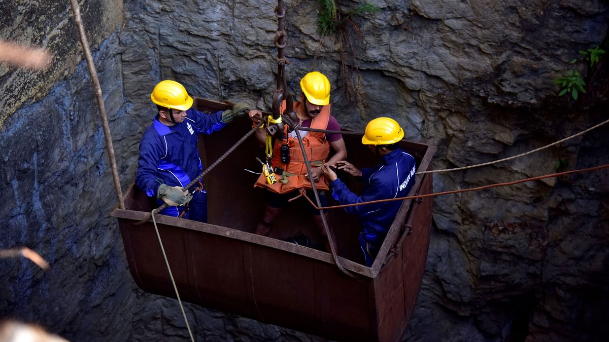 Divers use a pulley to enter a coal mine in Meghalaya. The participation of the private sector will generate additional economic activity and is expected to create an additional 5.5 million jobs in the country.