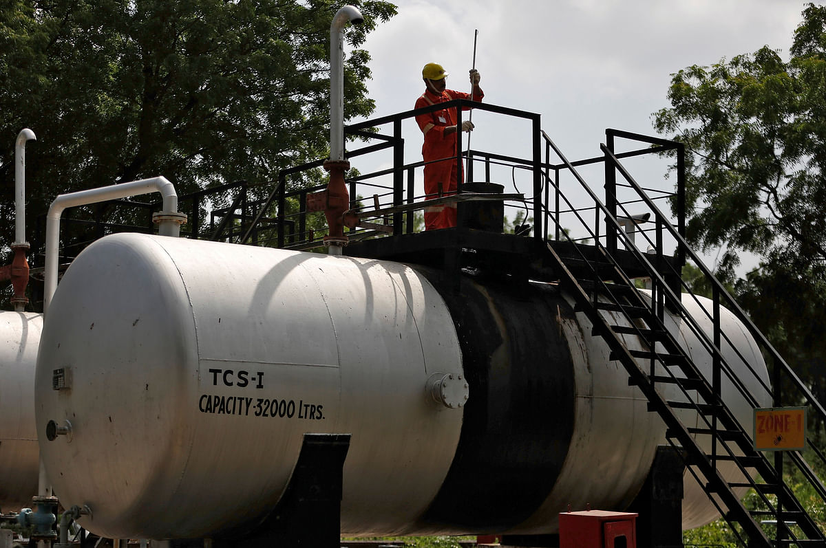 A technician works inside the Oil and Natural Gas Corp (ONGC) group gathering station on the outskirts of Ahmedabad. ONGC saw its contribution to the national production jump to more than 70% from under 53% a decade back.