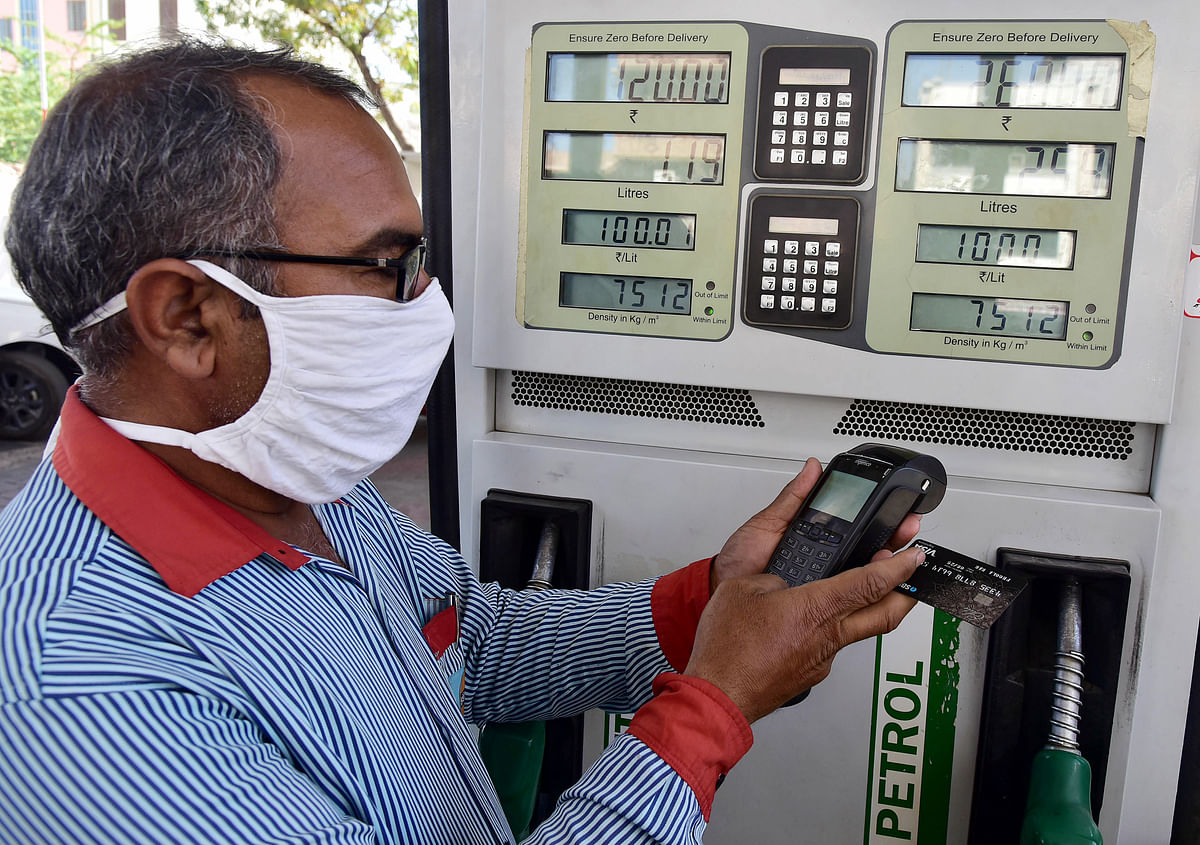 An attendant accepts payment through the digital mode from a customer at a petrol pump. The increasing adoption of digital payments and e-commerce by Indian businesses augurs well for the future.