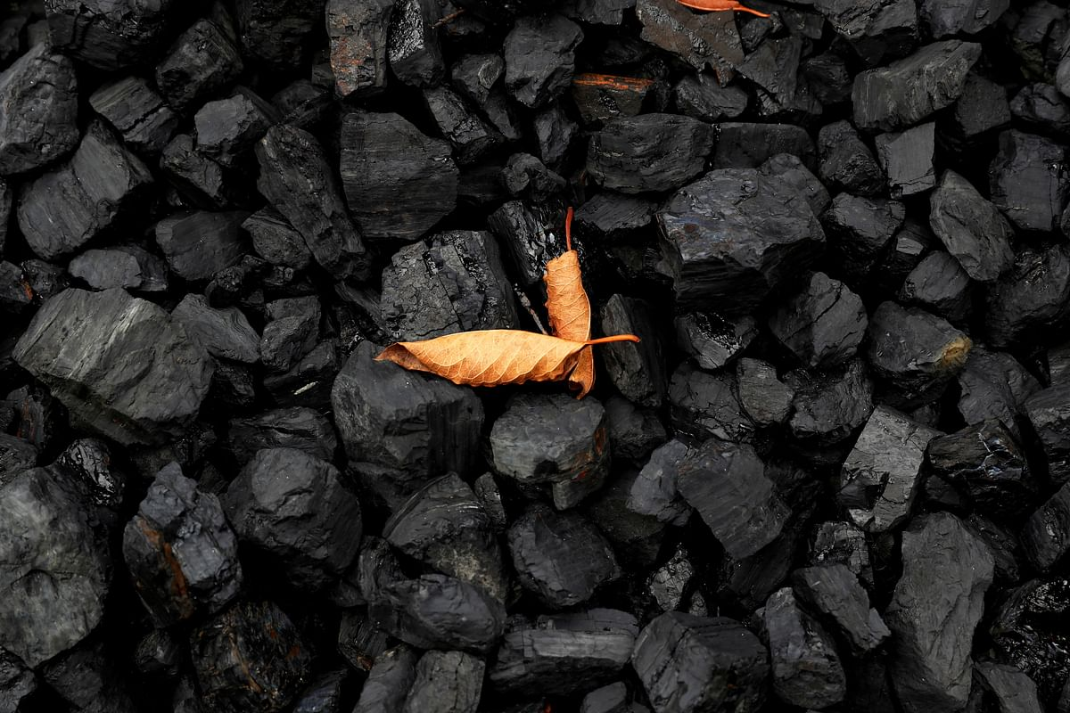 Coal reserves being dug up. India's ambitious renewable energy target of 450 Gigawatts by 2030 shows its commitment. Despite the country's development challenges.