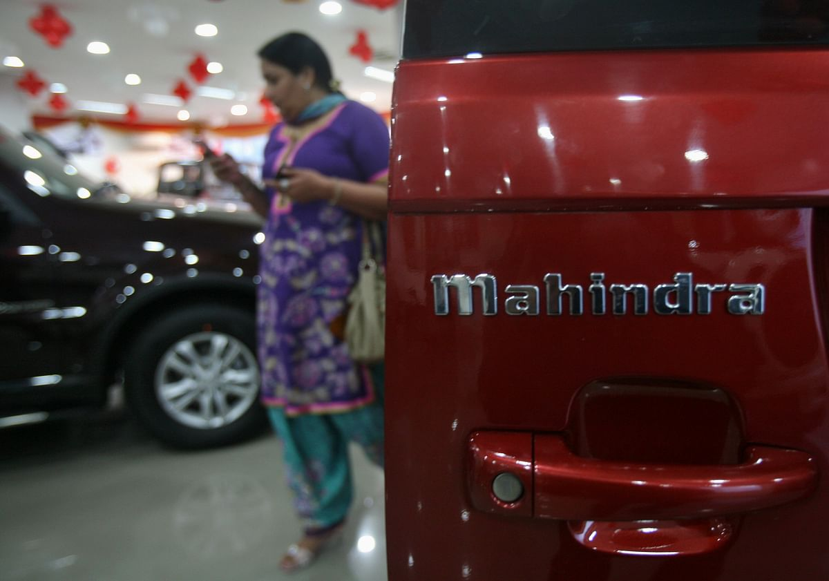 A customer walks inside a Mahindra cars showroom. Fitch said it expects the RBI to keep the policy rate stable in the coming year following 115 basis points in cuts since March 2020.
