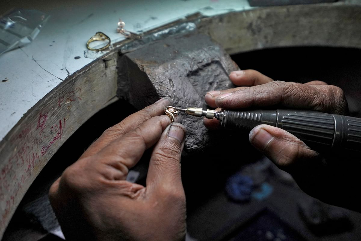 An employee fills a ring at a diamond jewellery manufacturing factory in Mumbai. With local manufacturing receiving a shot in the arm employment is set to rise in the sector.