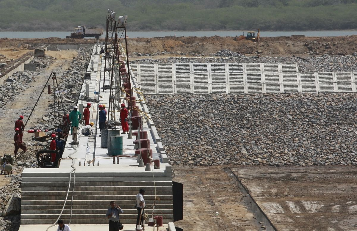 Workers are seen on a jetty at a construction site of Hambantota port in Hambantota, about 240km (150 miles) south of Colombo. The EU's agreements with China has run foul due to European sanctions imposed in response to the discrimination against Uighurs and other human rights violations China is accused of.