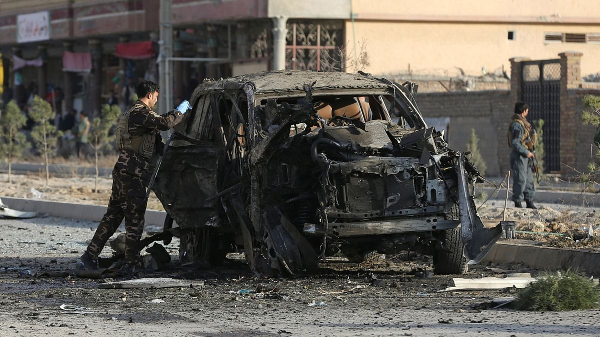 A member of the Afghan security forces inspects the site of a suicide blast in Kabul. Successive US presidents have been vocal about their troop's departure from Afghanistan.