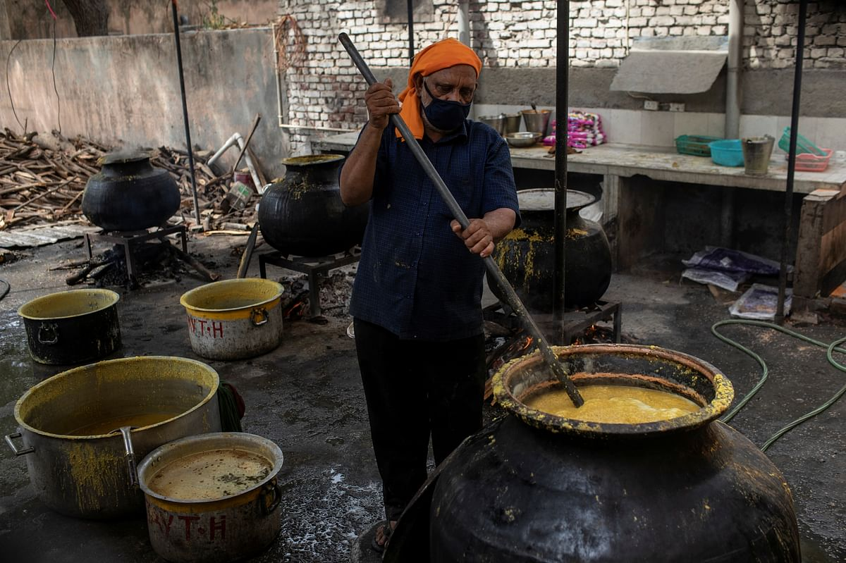 A cook makes food that will be distributed among migrant labourers and homeless people by Indian Red Cross Society. Many companies are particularly concerned about the possibility of a labour crunch.