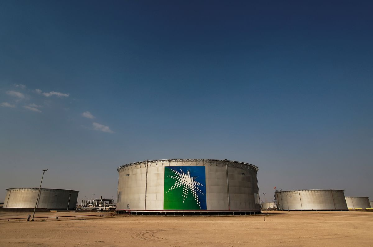 Branded oil tanks at Saudi Aramco oil facility in Abqaiq. Global oil and gas giants such as ExxonMobil, Saudi Aramco and ADNOC are exploring further investments in India.