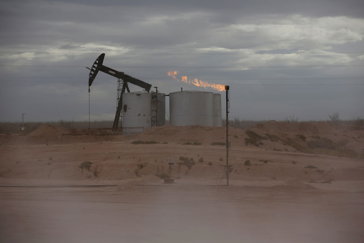Caption: Carbon credits do not reduce pollution from a given barrel of oil, though proponents of offset programs argue that credit purchases help finance clean-energy efforts that otherwise would not be profitable.
