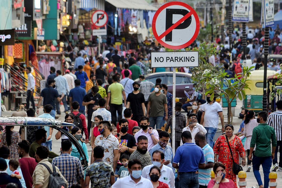 Crowds at Karol Bagh in New Delhi. The IMF's forecast about India is also largely in line with the outlook of other global financial agencies and experts.