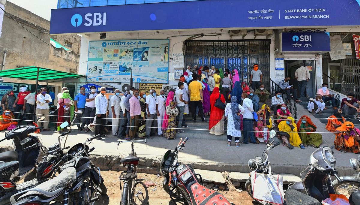 People stand in long queues outside State Bank of India for their pension payment. A report from FIS in September 2020 found that 68% of Indian consumers were using online or mobile banking to conduct financial transactions which is a shot in the arm for IT.